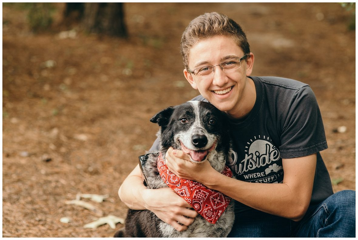 senior boy with dog