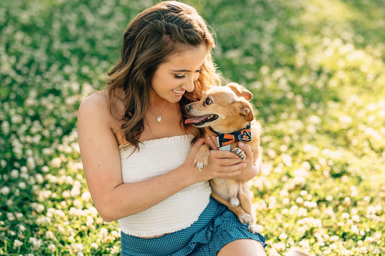 girl cuddling her dog with an Auburn collar