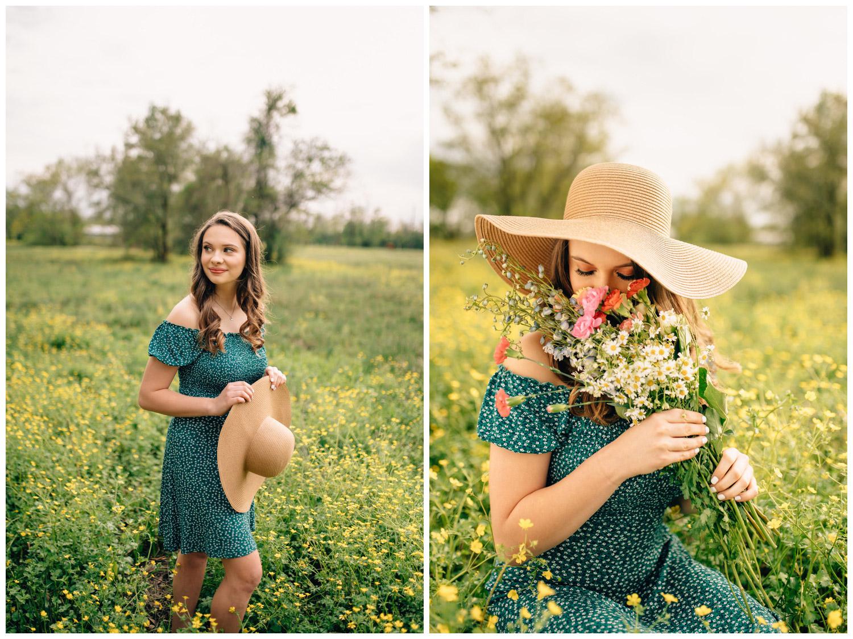 senior girl in field smelling flowers