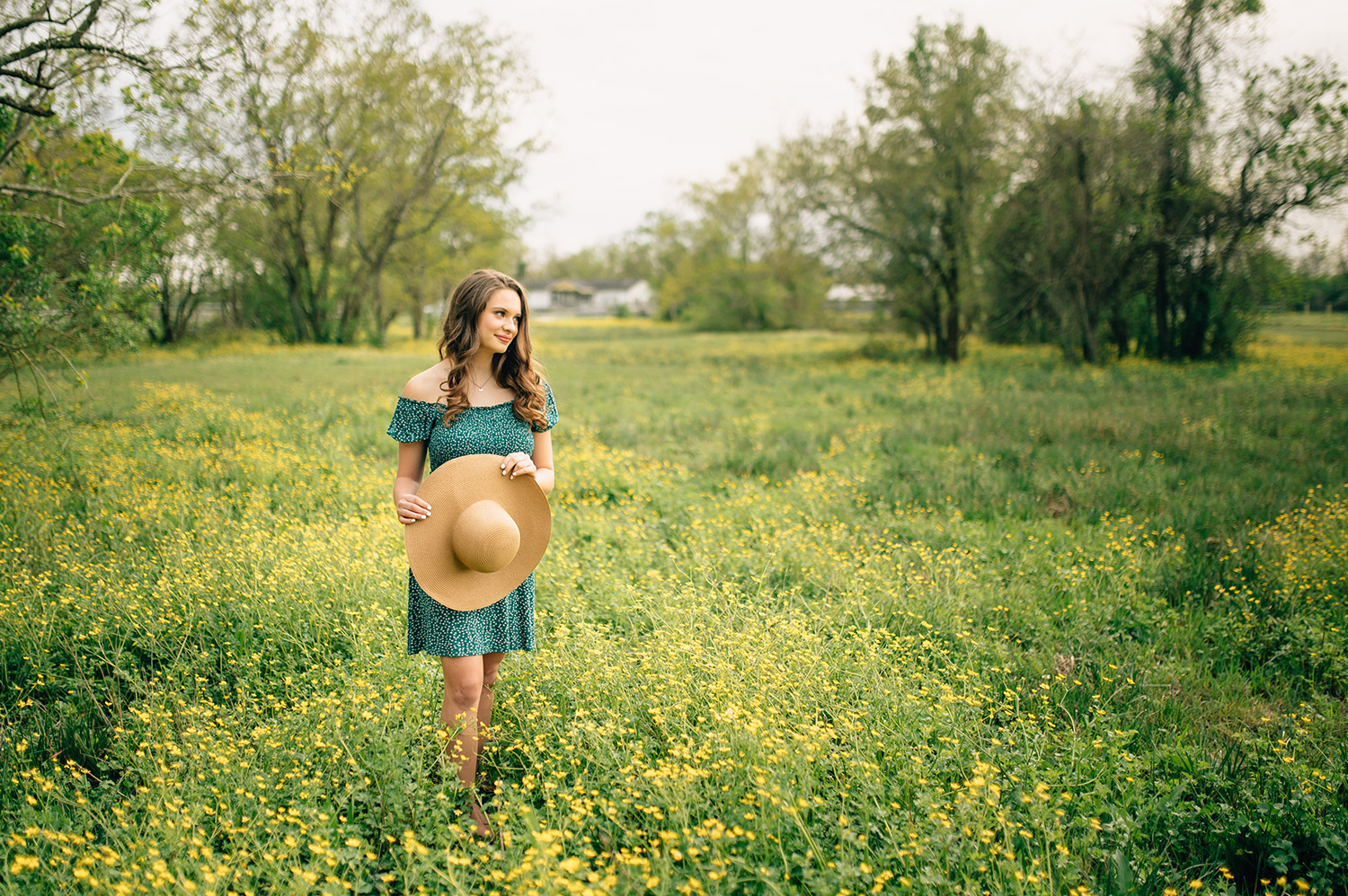 girl with sunhat in beautiful flowery field