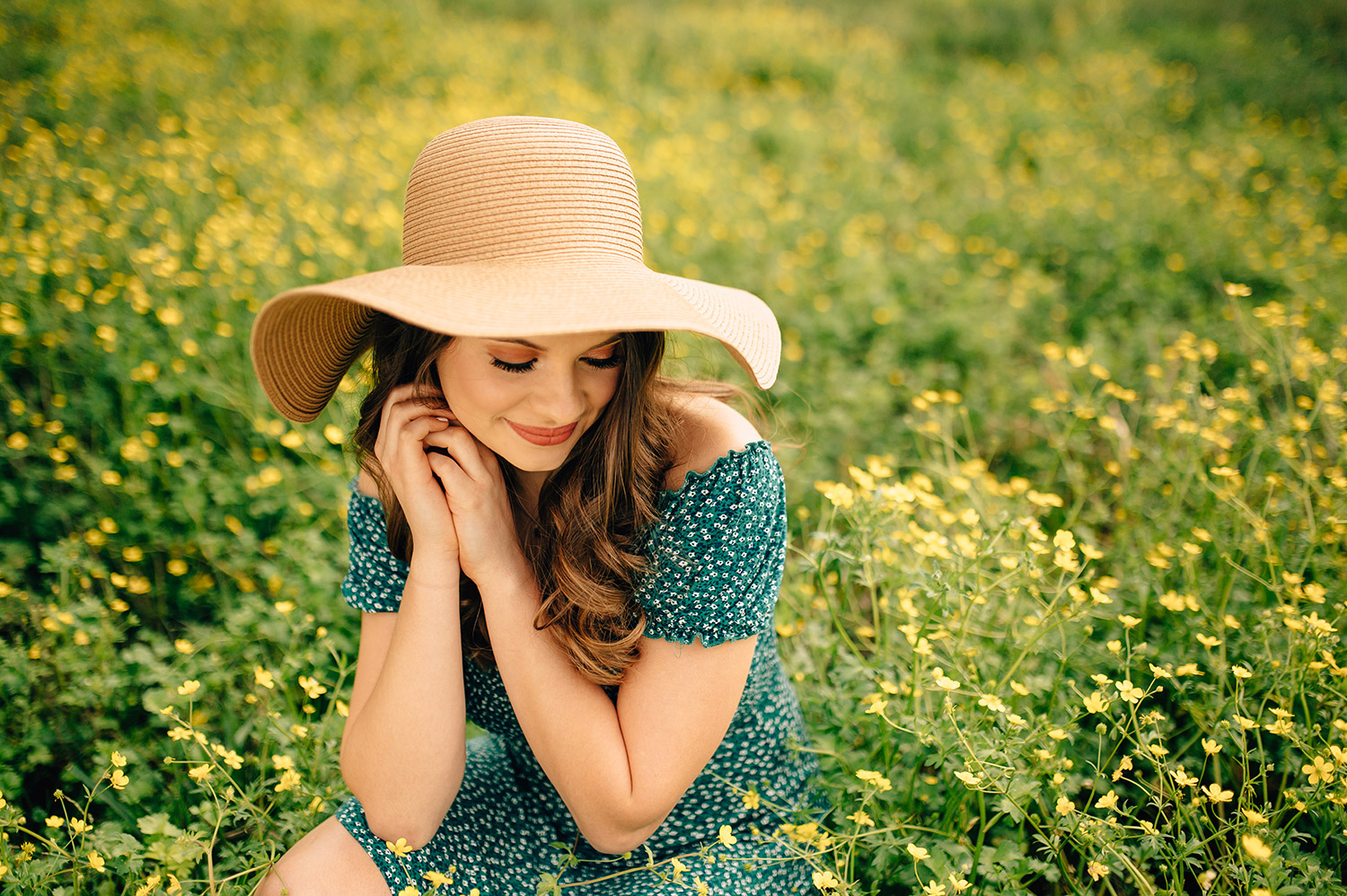 teenage girl in green dress and sunhat