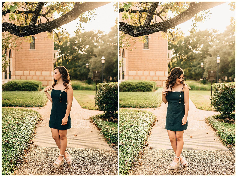 senior girl standing in green dress looking over shoulder