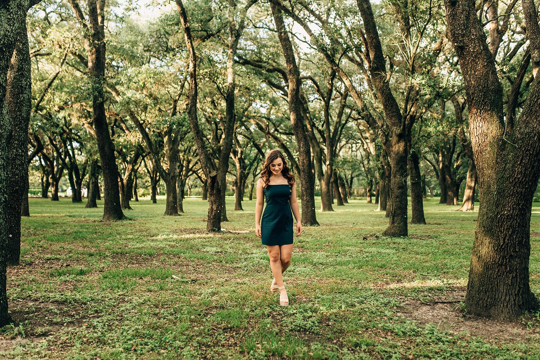 senior girl wandering through the woods of Houston