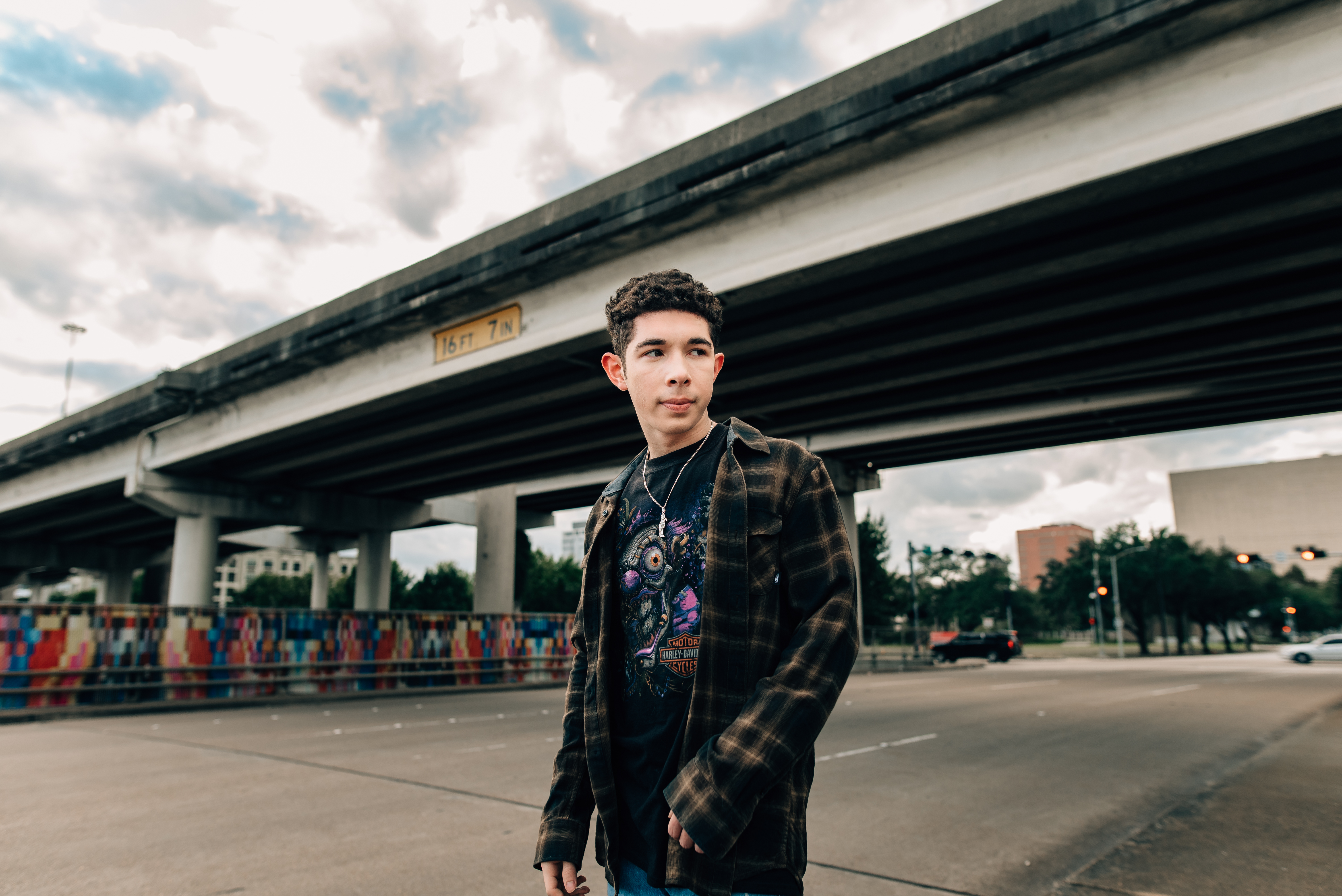 urban shoot for a senior guy by an overpass highway